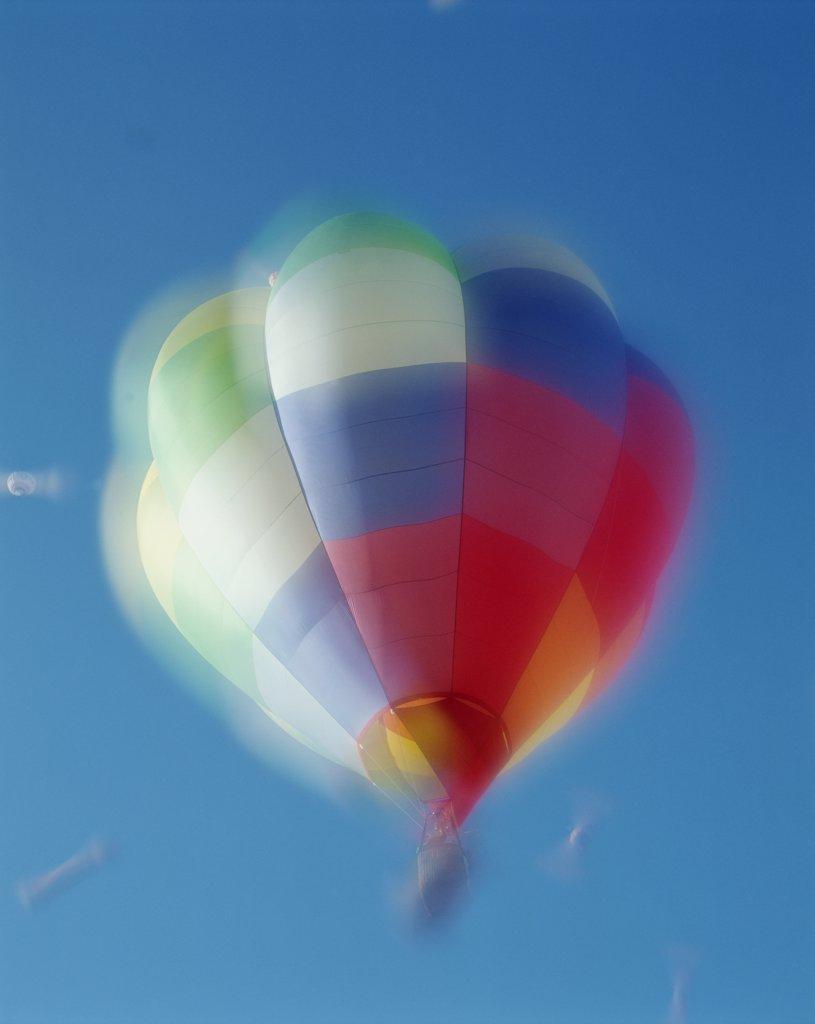 Stock Photo: 1606-145155 USA, New Mexico, Albuquerque, Colourful Hot Air Balloon in Sky
