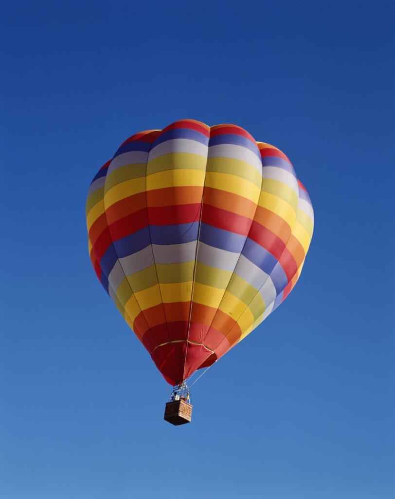 USA, New Mexico, Albuquerque, Colourful Hot Air Balloon in Sky : Stock Photo
