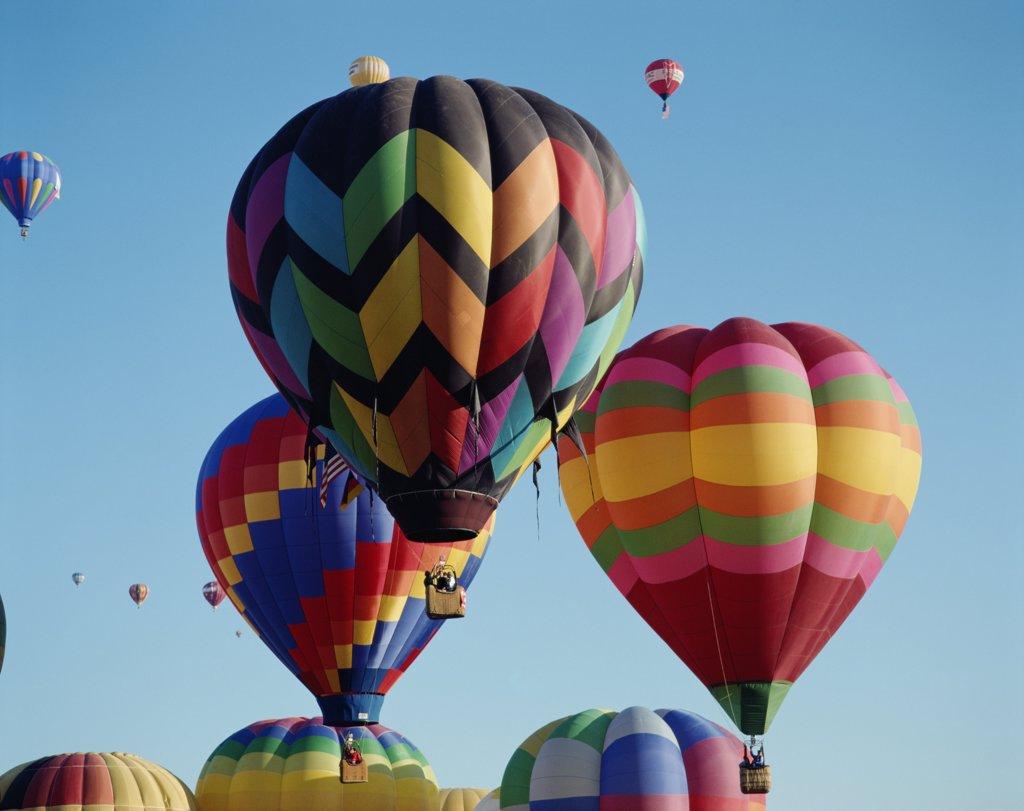 Stock Photo: 1606-145197 USA, New Mexico, Albuquerque, Colourful Hot Air Balloons in Sky