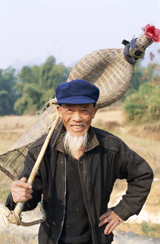 China, Guangxi Province, Guilin / Yangshou, Elderly Fish Farmer with Traditional Fishing Basket : Stock Photo