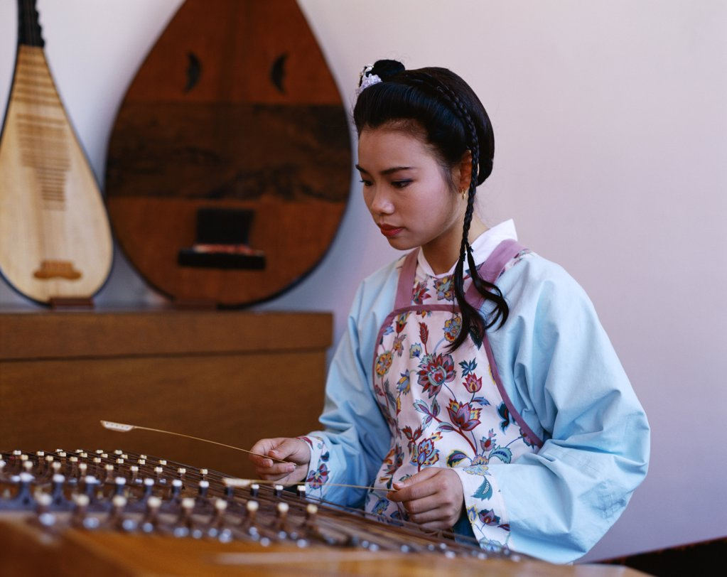 China, Beijing, Women Dressed in Traditional Costume Playing Musical Instrument / Zither : Stock Photo