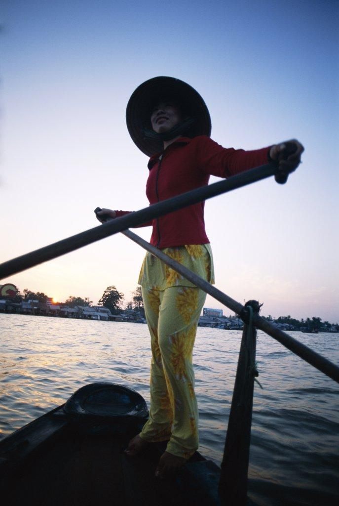 Vietnam, Mekong Delta, Cantho, Boat Woman on Mekong River / Sunrise : Stock Photo