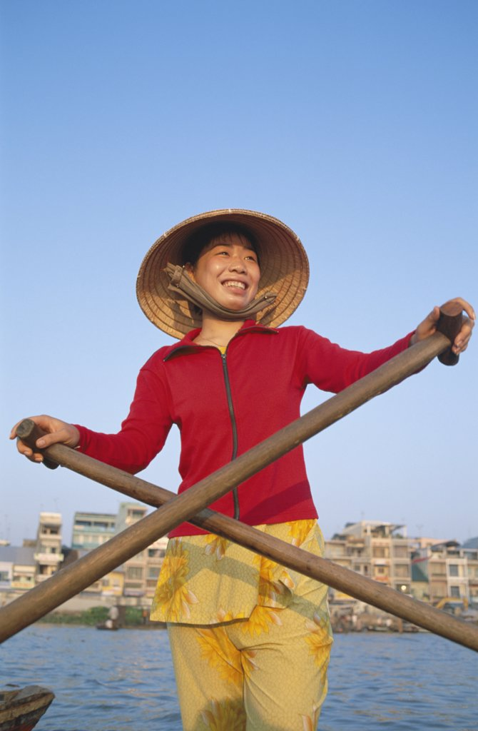 Stock Photo: 1606-145744 Vietnam, Mekong Delta, Cantho, Boat Woman on Mekong River