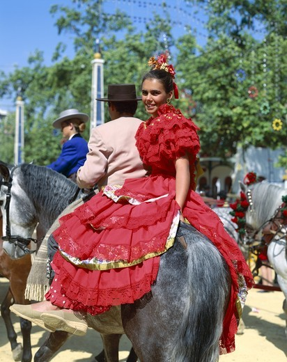 Spain, Andalusia, Jerez de la Frontera, Fiesta / Horse Fair / Woman Dressed in Andalucian Costume : Stock Photo