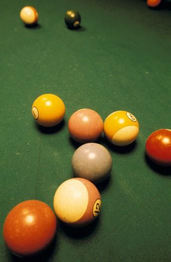 Stock Photo: 1606-15066 Billiard balls lying on green carpet