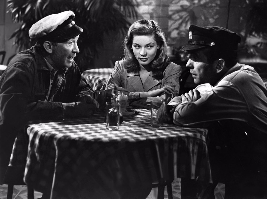 Stock Photo: 1606-153226 Walter Brennan, Lauren Bacall, Humphrey Bogart / To Have And Have Not 1944 directed by Howard Hawks