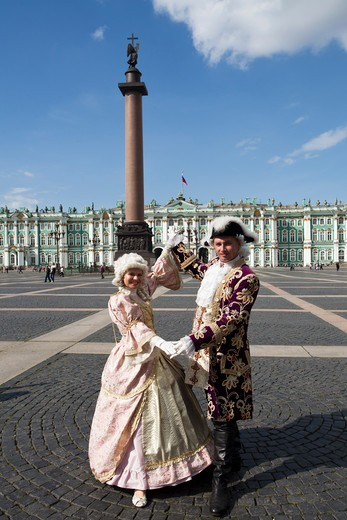 Stock Photo: 1606-156870 Rusia , San Petersburg City, Couple in traditional cloths ,Dvortsovaya Square , Alexander Column and the Winter Palace Bldg.