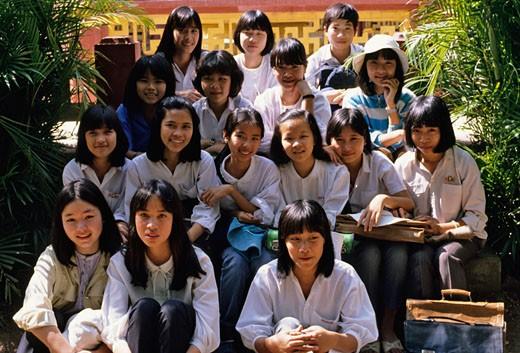 Vietnam, Hue, class of young school girls, posing, wearing white shirts, : Stock Photo