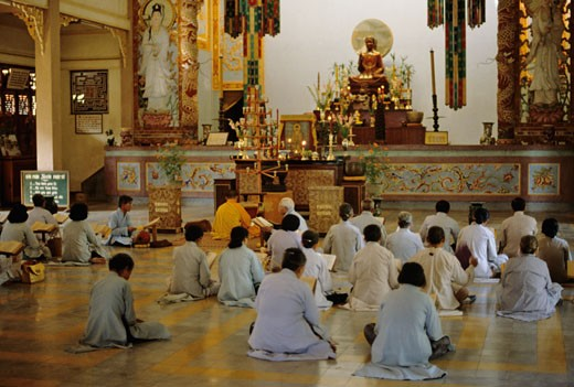 Stock Photo: 1606-15719 Vietnam, Nha Trang, buddhist temple Trai Thuy, believers sitting on the floor praying