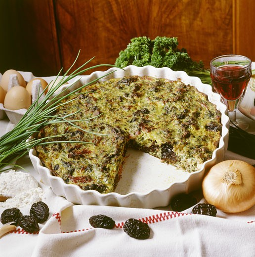 Pounti (prune and onion pie) flour, glass of wine, eggs : Stock Photo