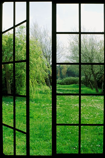 Stock Photo: 1606-15869 Special effect of window opening on garden, trees, lawn and flowers