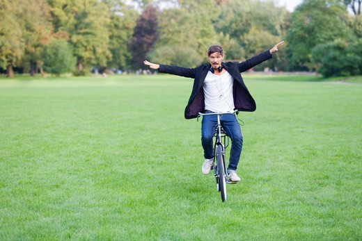 Man in park with bicycle : Stock Photo