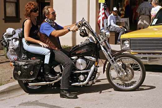 Stock Photo: 1606-15973 US, Arizona, 66 road, Seligman,couple on motorcycle in street