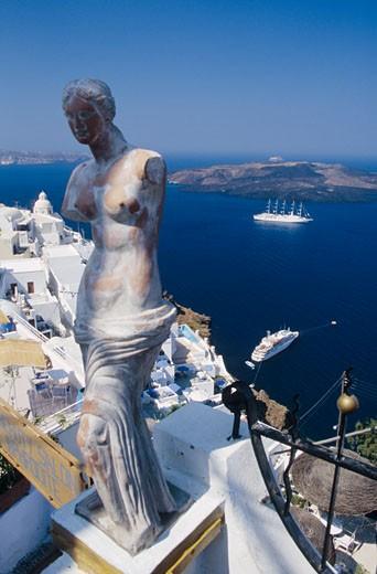 Stock Photo: 1606-16126 Greece, Cyclades archipelago, Santorini Island, cruise boat on blue sea, Aphrodite statue, terraces, high angle view