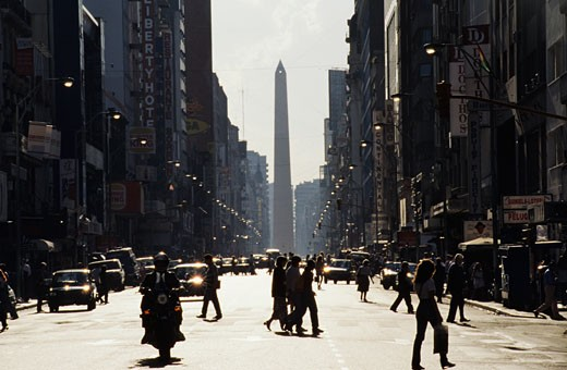 Argentina, Buenos Aires, Corrientes avenue, passers-by, obelisk in background : Stock Photo