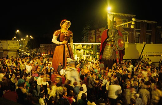 Stock Photo: 1606-16374 France, Nord, Douai, carnival, crowd in street, by night, with giants