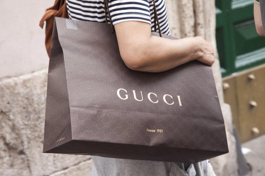 Stock Photo: 1606-165407 Italy,Rome,Via Dei Condotti,Street Scene,Woman Holding Gucci Shopping Bag