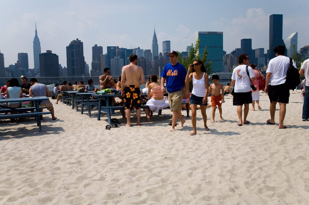 Stock Photo: 1606-168830 New York - United States, Harry's at Water Taxi Beach, bar, people at the beach, volley at Long Island city in front of Midtown Manhattan