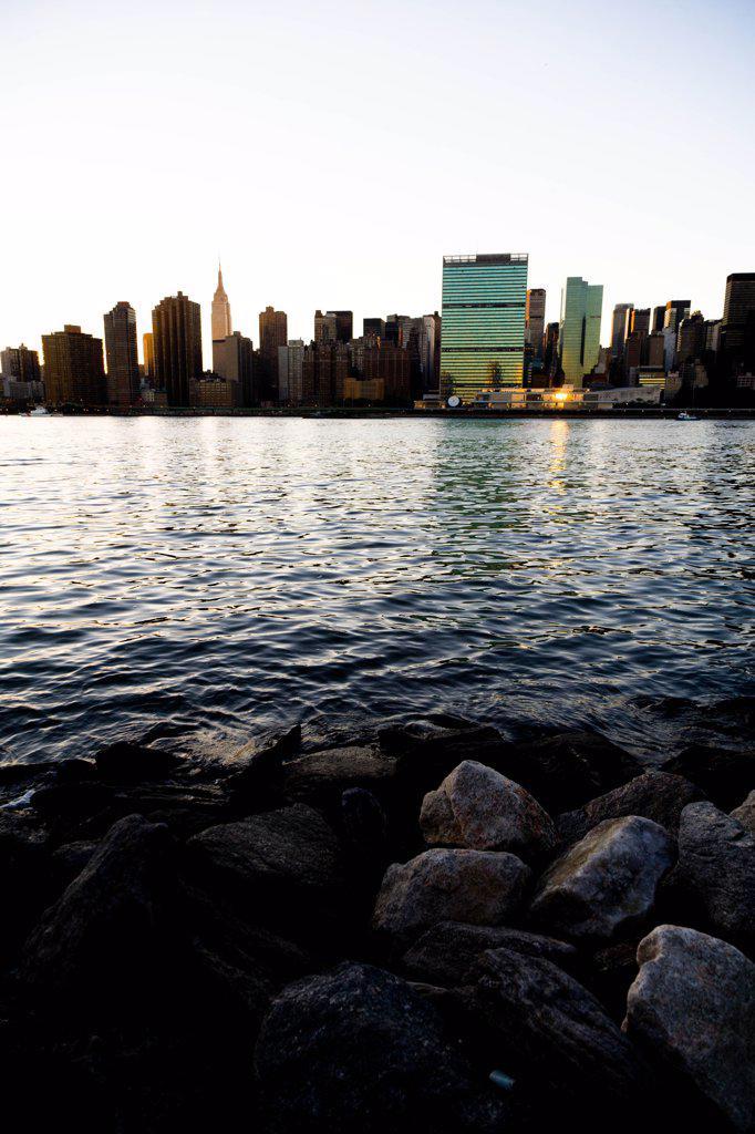 New York - United States, Manhattan Skyline, East river, at sunset : Stock Photo