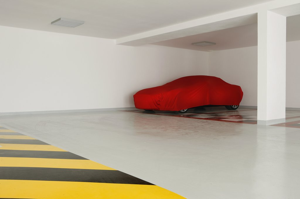 Stock Photo: 1606-169943 Car in a garage covered with a red tarpaulin