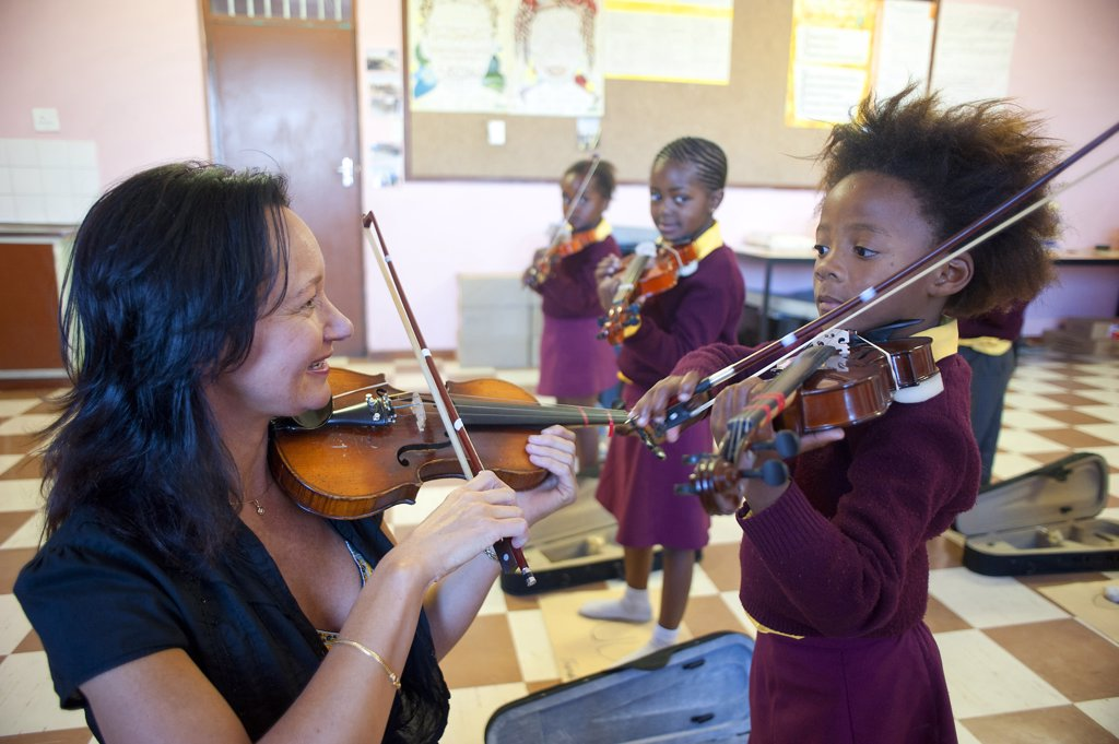 South Africa, Cape Town, Township of Gugulethu, Primary school, students playing violin : Stock Photo