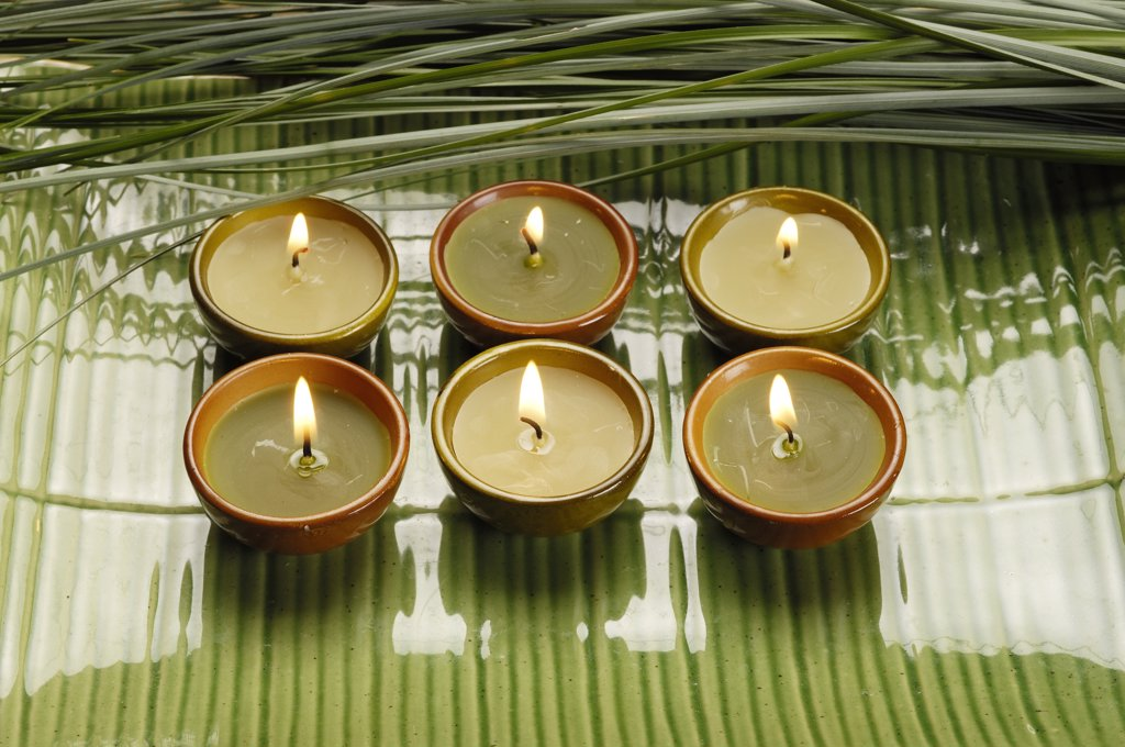 Six lightened candles on green porcelaine : Stock Photo
