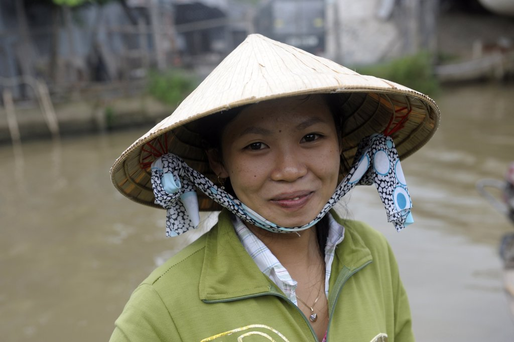Asia, Southeast Asia, Vietnam, delta of Mekong, Can Tho, portrait of a woman wearing a traditional conical hat : Stock Photo