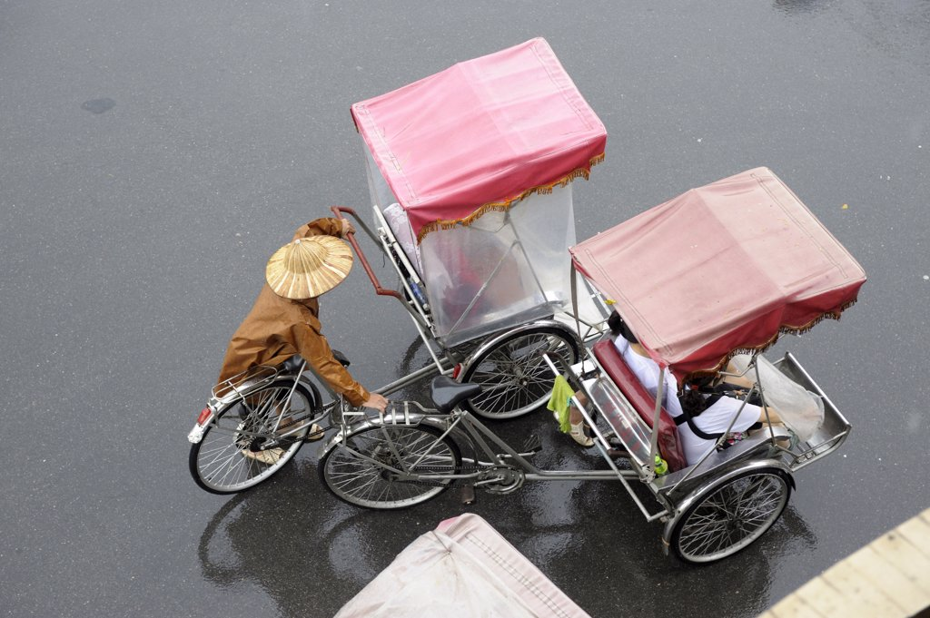 Asia, Southeast Asia, Vietnam, Hanoi, high angle view of a man driving a cyclo : Stock Photo