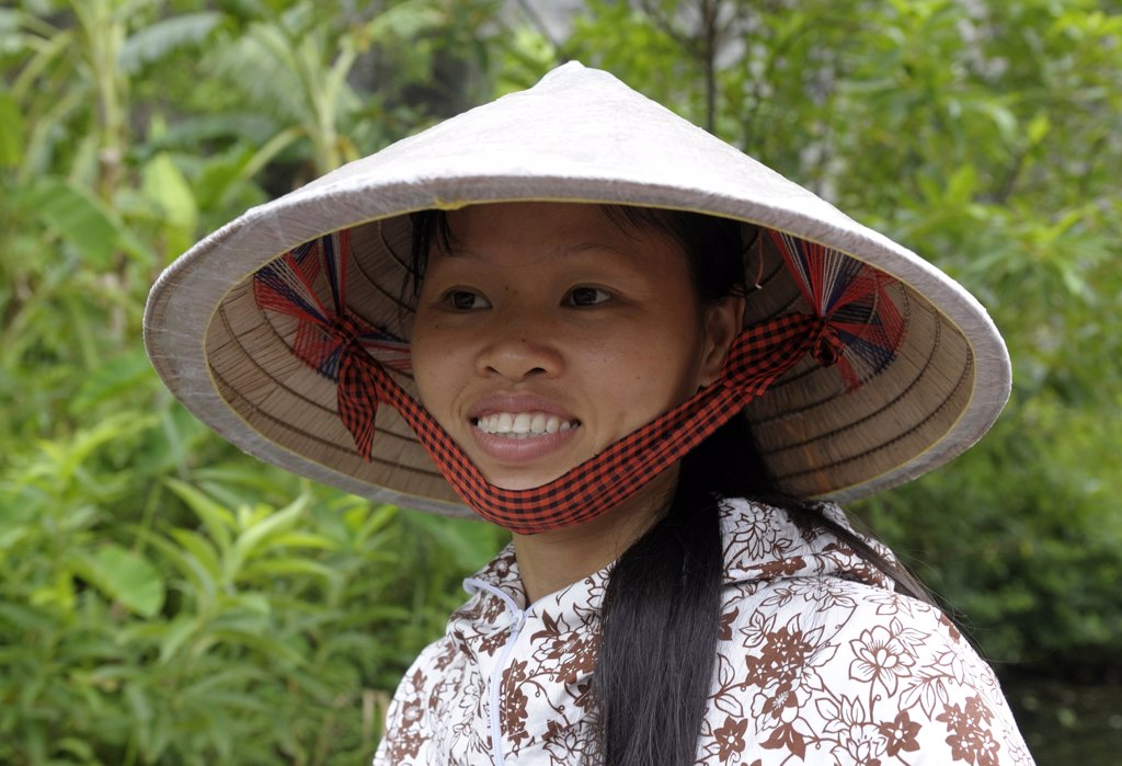 Stock Photo: 1606-171621 Asia, Southeast Asia, Vietnam, Tam Coc, portrait of a woman wearing the traditional conical Asian hat