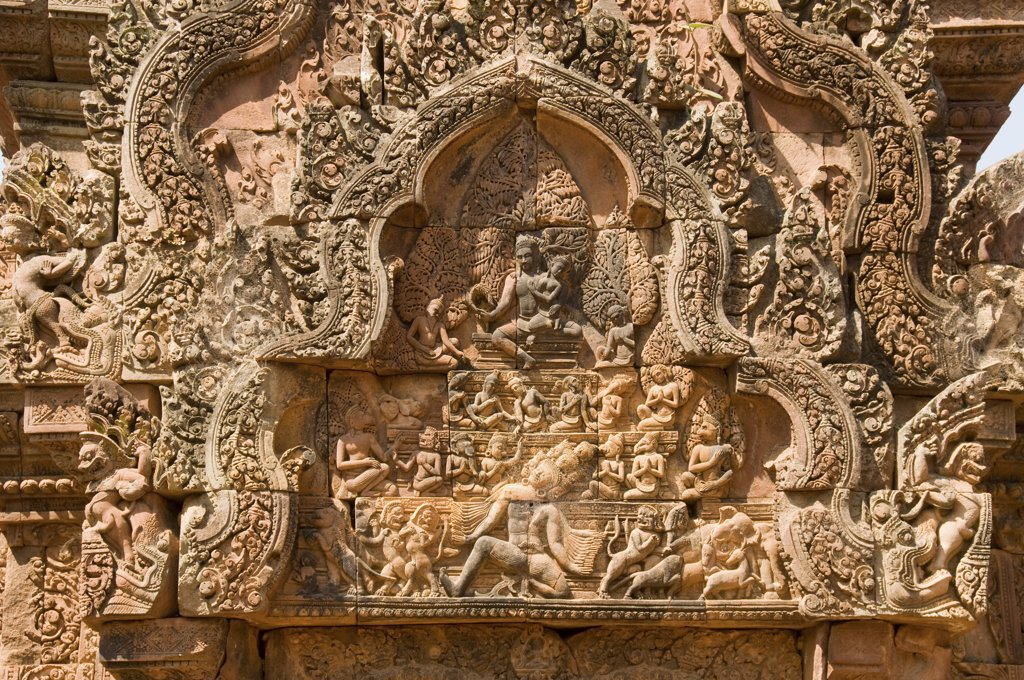 Asia; Cambodia; Siem Reap Banteay Srei; temple dedicated to the Hindu god Shiva; bas relief sculpture; next to the main entrance gate : Stock Photo
