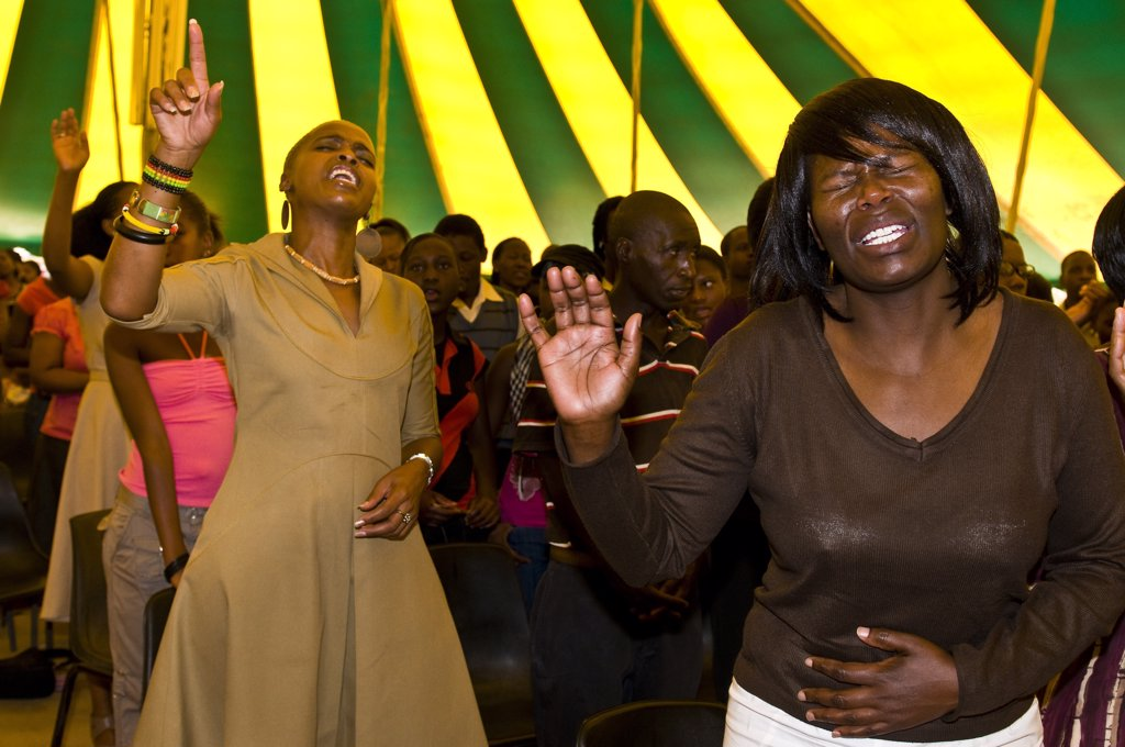 Africa, South Africa, Gauteng Province, Johannesburg city, Soweto (South Western Township), Orlando West Quarter, believers in tears during a messa in a gospel church : Stock Photo