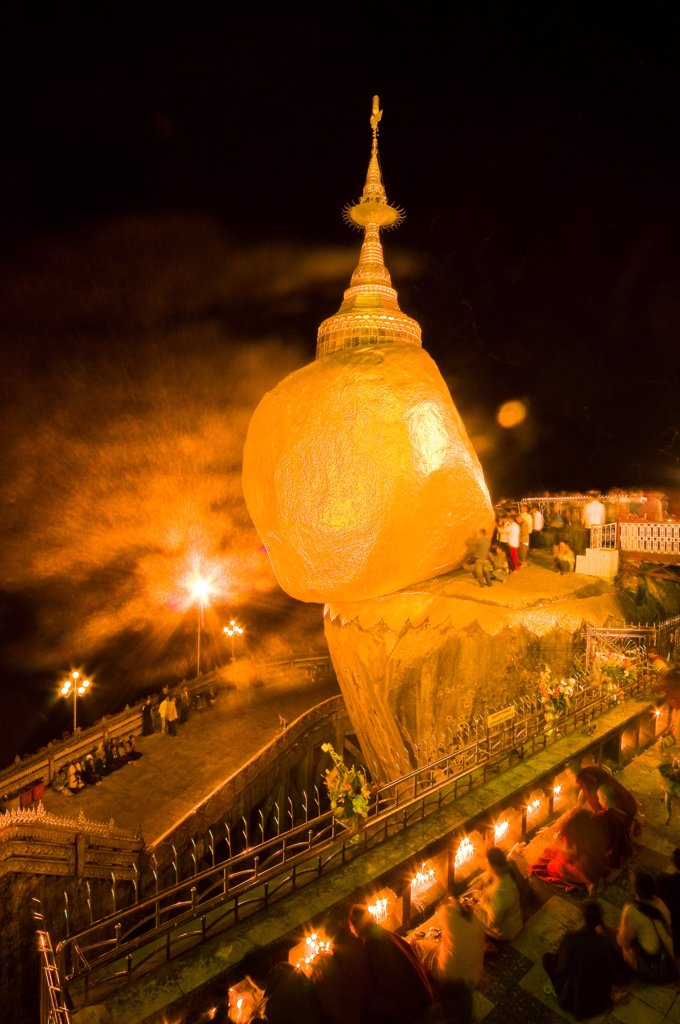 Stock Photo: 1606-173322 Myanmar (Burma), Mon State, Kyaiktiyo, Golden Rock, with the paya Shwedagon of Yangon and the paya Mahamuni of Mandalay, this Buddhsit site is one of the most revered in Myanmar, when night comes pilgrims keep on chanting psalms, light candles and meditat