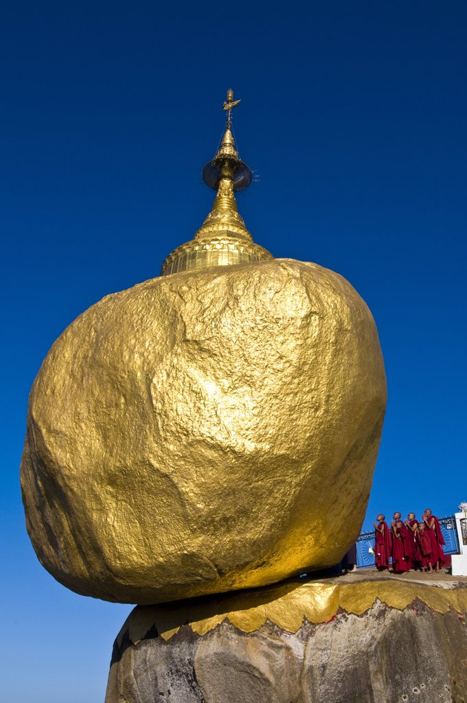 Stock Photo: 1606-173533 Myanmar (Burma), Mon State, Kyaiktiyo, Golden Rock, with the paya Shwedagon of Yangon and the paya Mahamuni of Mandalay, this Buddhsit site is one of the most revered in Myanmar, on the top of Kyaikto Mount (1100 meters high), this rock of 611,45 tons top