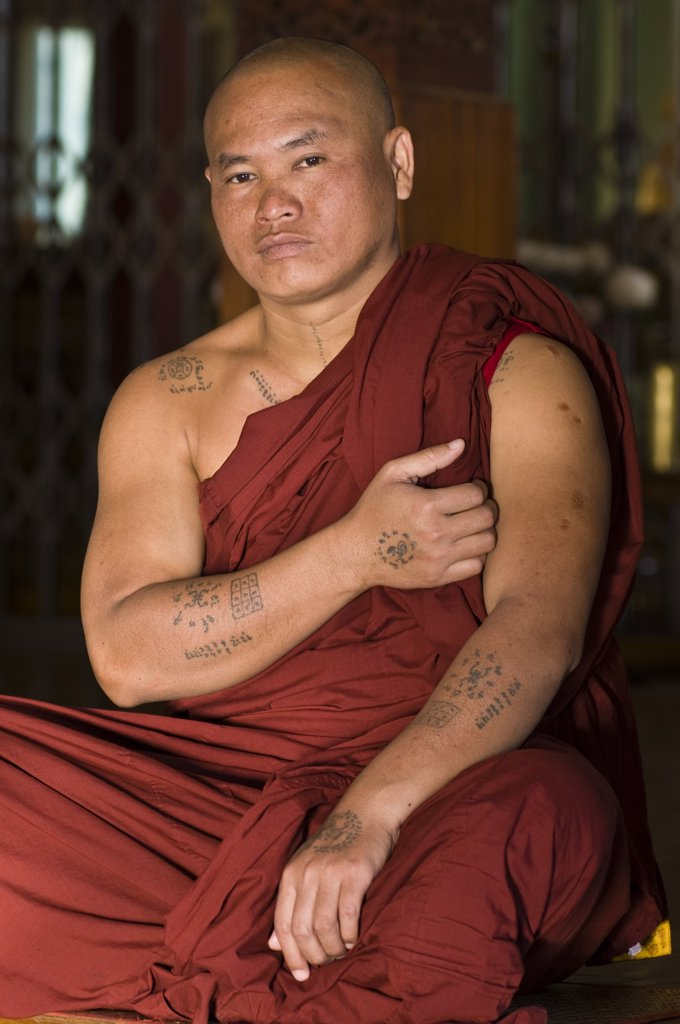 Myanmar (Burma), Shan State, Inle Lake, village of Nam Hu, the Paung Daw Oo Pagoda, Nam Hu monastery, the monk U Khay Mein Da has tatooed garoudas, snakes or spiders on his arms as protective amulets : Stock Photo