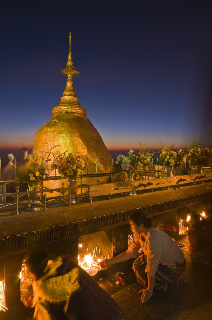 Stock Photo: 1606-173670 Myanmar (Burma), Mon State, Kyaiktiyo, Golden Rock, with the paya Shwedagon of Yangon and the paya Mahamuni of Mandalay, this Buddhsit site is one of the most revered in Myanmar, when night comes pilgrims keep on chanting psalms, light candles and meditat