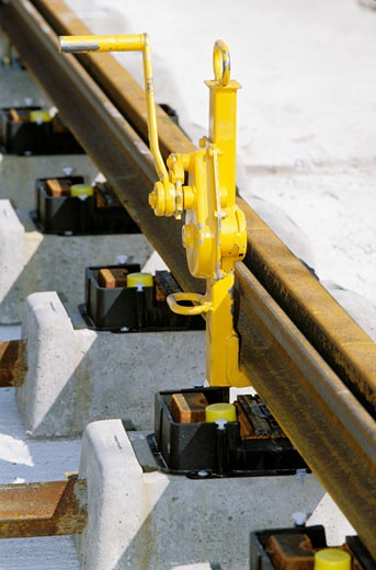 France, Rhône-Alpes, Rhône, Lyon, tramway construction site, close-up of  yellow pliers and crank on rail : Stock Photo