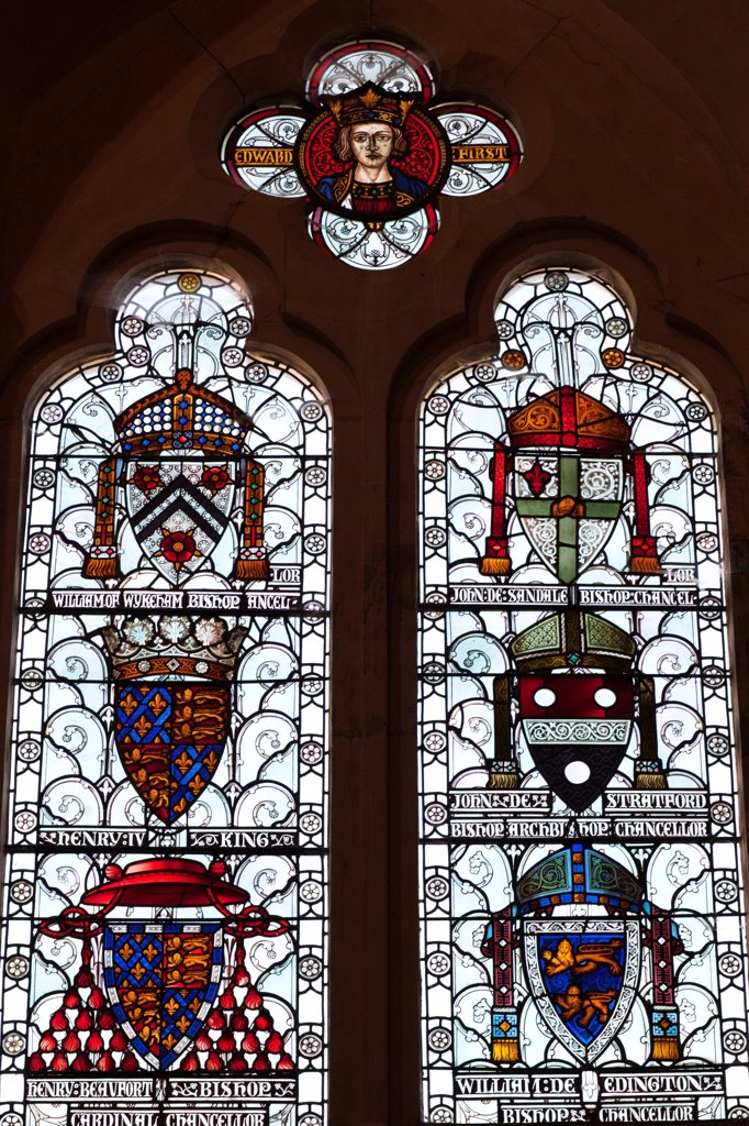 England,Hampshire,Winchester,The Great Hall,Stained Glass Window depicting Coats of Arms : Stock Photo