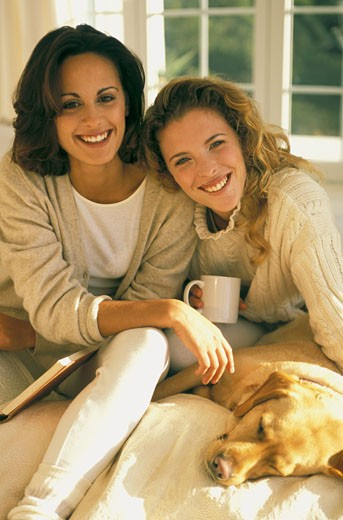 2 young women smiling for the camera : Stock Photo
