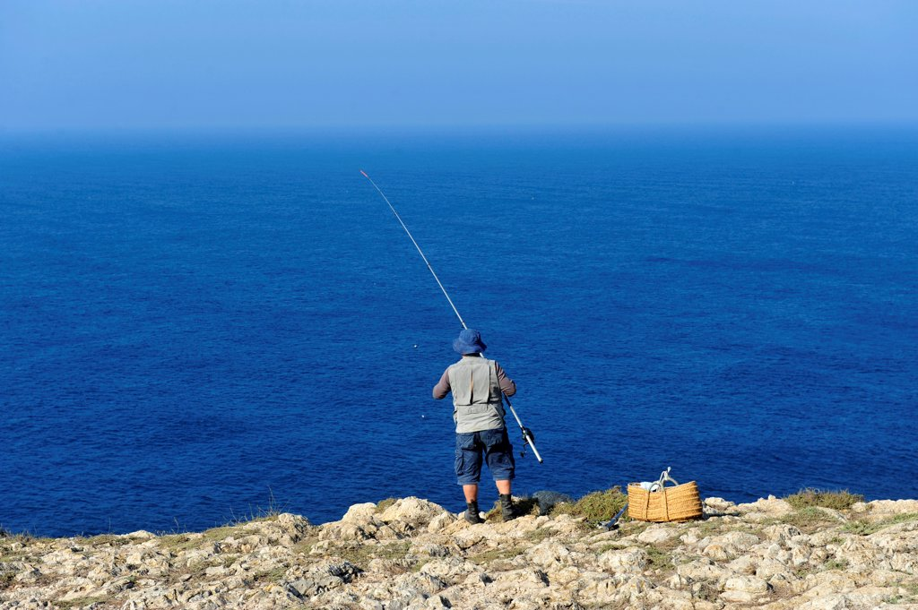 Stock Photo: 1606-178569 Man fishing near Cabo de Vincente,the Portuguese Coast in Algarve,Portugal,South Europa,Europa