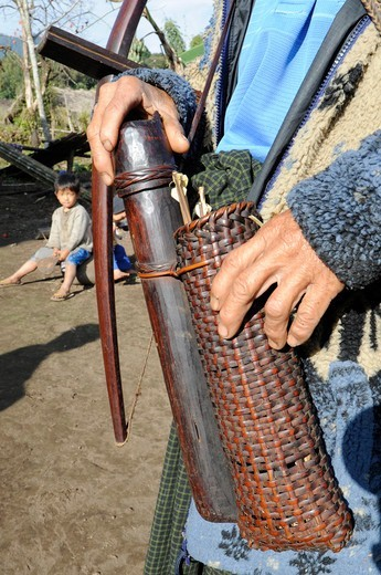 Burma, Myanmar, Putao, details of a bamboo crossbow and a quiver of a traditional hunter : Stock Photo