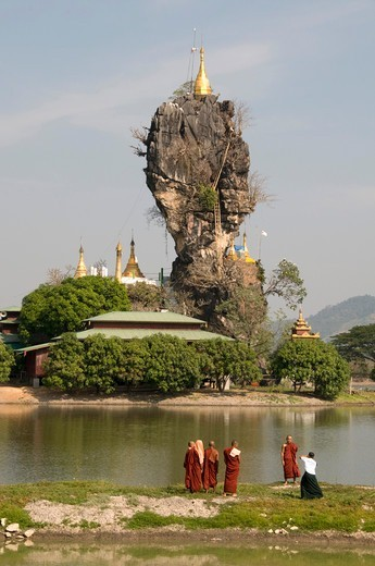Stock Photo: 1606-179536 Myanmar Burma HPA AN a group of monks are standing in front of the  KYAUK KA LAT pagoda perched on an island