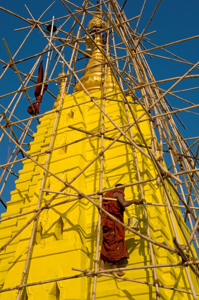 Stock Photo: 1606-179542 Myanmar Burma HPA AN 2 monks are working on a bamboo scaffolding painting in yellow the stupa of a pagoda