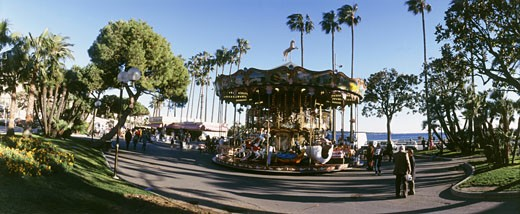 France, Provence Alpes Cote d'Azur, Alpes Maritimes, Cannes, Croisette, merry-go-round, wide-angle lens : Stock Photo