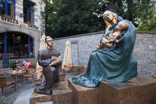 Stock Photo: 1606-182245 Belgium,Tournai,Statue Dedicated to the Artist Rogier de le Pasture aka Roger van der Weyden showing him Painting the Virgin Mary and Child Jesus