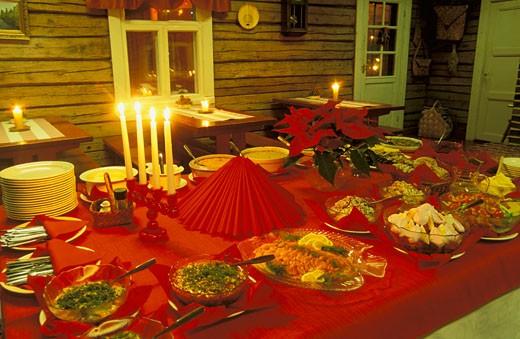 Finland, Vuokatti, Sotkamo, table at Christmas, night, candles : Stock Photo