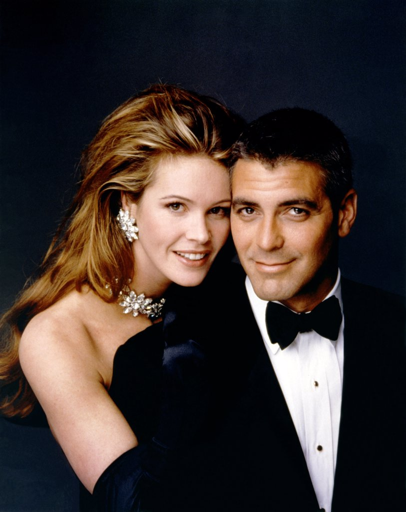 Elle Macpherson and George Clooney , Batman & Robin , 1997 directed by Joel Schumacher (Warner Bros. Pictures) : Stock Photo