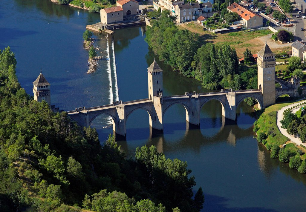 Stock Photo: 1606-185908 France, Lot (46) Cahors town located in a meander of the Lot, crossing the Lot, The bridge is a bridge Valentré fortified fourteenth century, classified historical monuments and UNESCO World Heritage, (aerial photo)