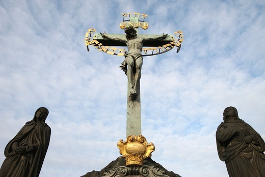 Stock Photo: 1606-187183 Statue of Jesus on the cross with Hebrew lettering on Charles bridge. Praha. Czech Republic.