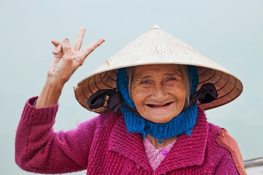 Stock Photo: 1606-187575 Vietnam,Hoi An,Portrait of Lady Wearing Conical Hat