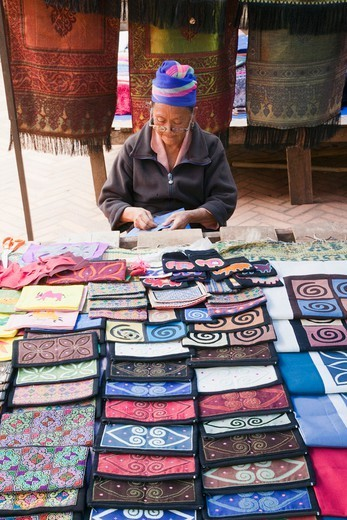 Laos,Luang Prabang,Ethnic Craft Night Market,Hilltribe Woman Selling Silk Purses : Stock Photo
